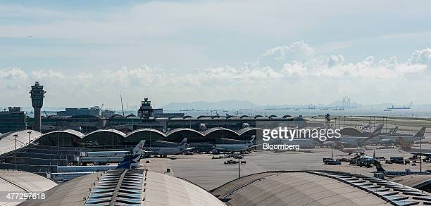 Aircraft stand parked at gates at Hong Kong International Airport in Hong Kong China on Monday June 15 2015 The Hong Kong government in March...