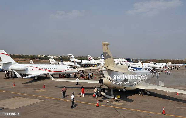 Aircraft stand parked on the tarmac at the India Aviation 2012 show at Begumpet Airport in Hyderabad on March 16 2012 The third edition of India...