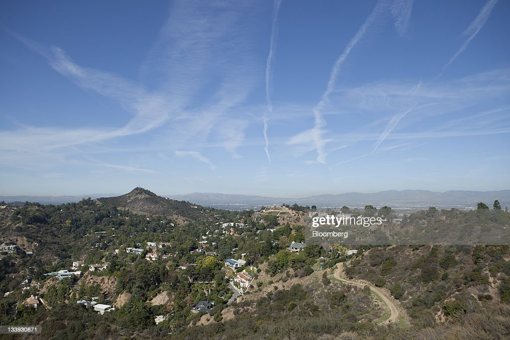 Aircraft vapor trails, also known as 'contrails,' are seen in the sky above homes sitting in the San Fernando Valley area of Los Angeles, California, U.S., on Thursday, Nov. 17, 2011. Los Angeles faces an almost $200 million deficit for the 2013 fiscal year and projected pension and salary increases for city employees totaling $479 million through 2015, analysts said this year. Photographer: Andrew Harrer/Bloomberg via Getty Images