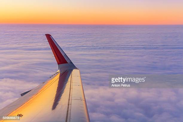 Aircraft wing above the clouds