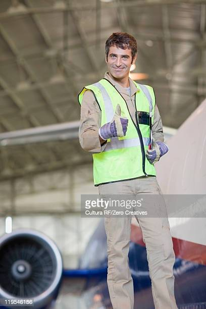 Aircraft worker giving thumbs up