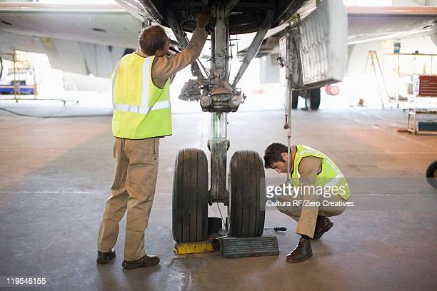 Aircraft workers checking wheels
