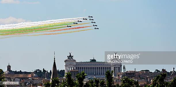 Aircrafts of the Italian Air Force aerobatic unit 'Frecce Tricolori' leave smoke trails in the colours of the Italian national flag over Rome's...