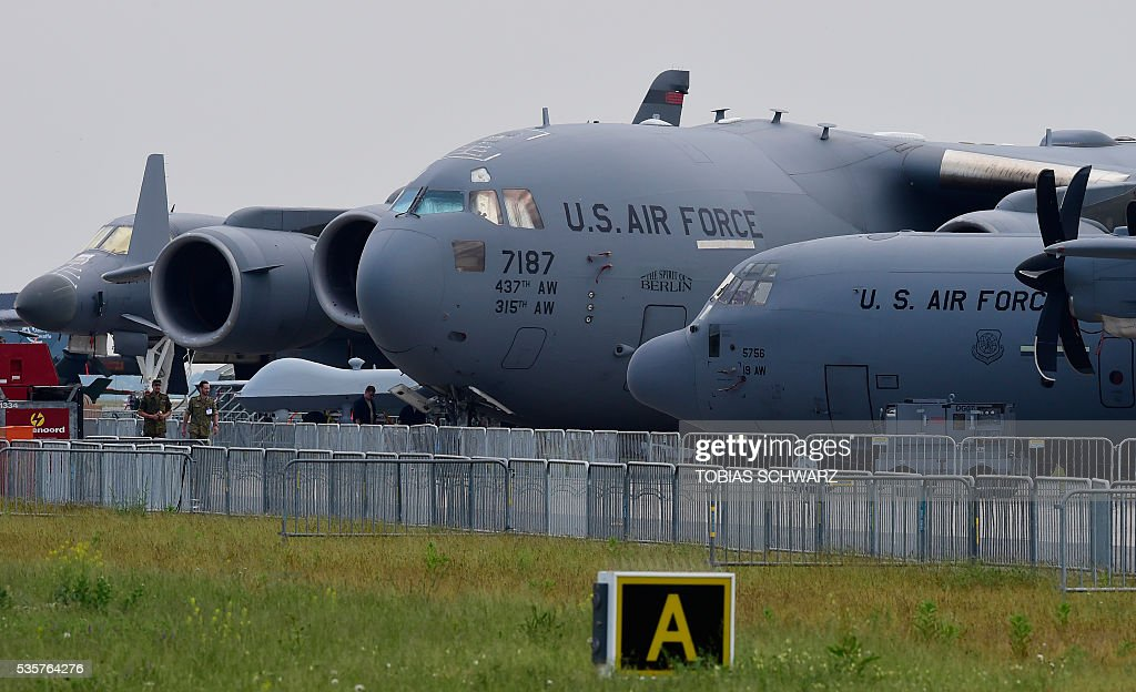 Aircrafts of the US Air Force are on display at the International Aerospace Exhibition (ILA) in Schoenefeld on May 30, 2016. The Aerospace Exhibition at Schoenefeld Airport takes place from June 1 to 4, 2016. / AFP / TOBIAS