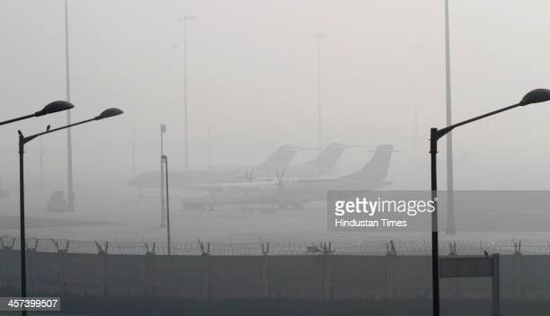 Aircrafts parked in T3 terminal IGI Airport due to heavy fog in the morning on December 17 2013 in New Delhi India Flight operations came to a...