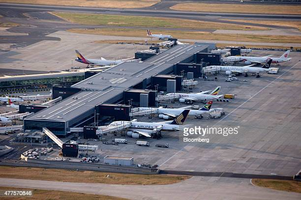 Aircrafts sit at a passenger terminal including aircrafts from Singapore Airlines South African Airways and Ethiopian Airlines at London Heathrow...