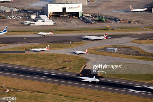 Aircrafts sit on the perimeter of the north runway at London Heathrow Airport including planes from British Airways Plc Deutsche Lufthansa AG and...