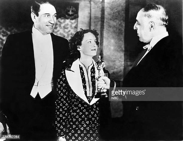 Presenters Victor McLaglen and Bette Davis present DW Griffith with a special award for creative achievements as a director and producer for...