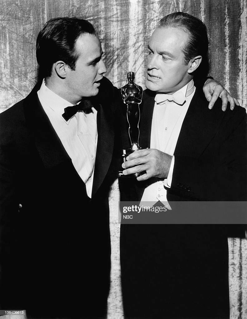 Best Actor Winner for 'On the Waterfront' Marlon Brando and host Bob Hope during the 27th Annual Academy Awards at the Pantages Theatre in Los...