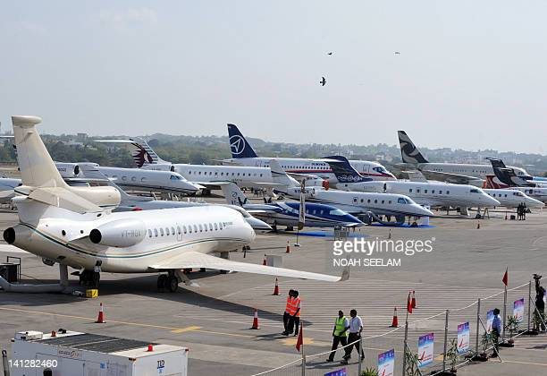 Airfrafts on static display are pictured on the opening day of the inaguration of the India Aviation2012 show at Begumpet airport in Hyderabad on...