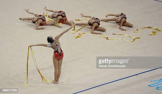 Airi Hatakeyama Mao Kunii Rie Matsubara Sayuri Sugimoto and Kiko Yokota of Japan compete in the Group Apparatus Ribbon Final during day 7 of the...