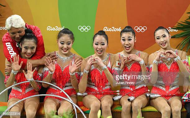 Airi Hatakeyama Rie Matsubara Sakura Noshitani Sayuri Sugimoto and Kiko Yokota of Japan await the scores during the Group AllAround Final on Day 16...