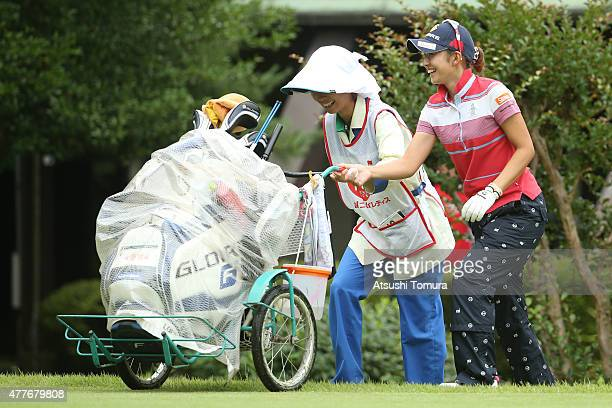 Airi Saito of Japan helps her caddie during the first round of the Nichirei Ladies at the Sodegaura Country Club Shinsode Course on June 19 2015 in...