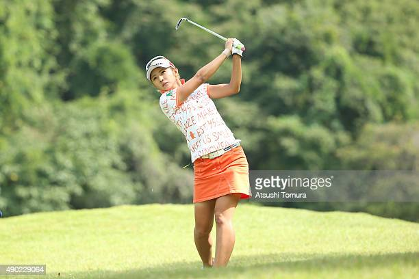 Airi Saito of Japan hits her second shot on the 5th hole during the final round of the Miyagi TV Cup Dunlop Ladies Open 2015 at the Rifu Golf Club on...