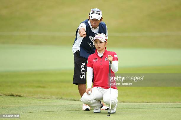 Airi Saito of Japan lines up her birdie putt on the 7th green during the second round of the Miyagi TV Cup Dunlop Ladies Open 2015 at the Rifu Golf...