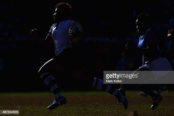 Airini Vuidravuwalu of Fiji breaks away to score a try during the girls match between Samoa and Fji in the rugby sevens competition at the Apia Park...