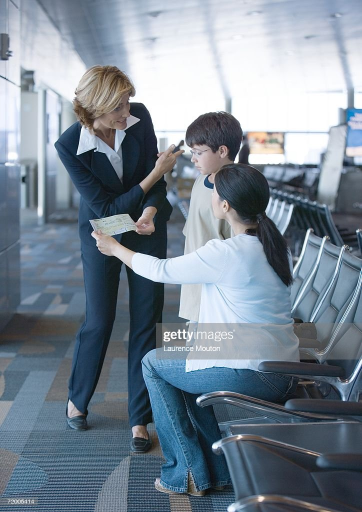 Airline attendant helping travelers