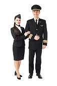 Airline crew stewardess and pilot isolated on white