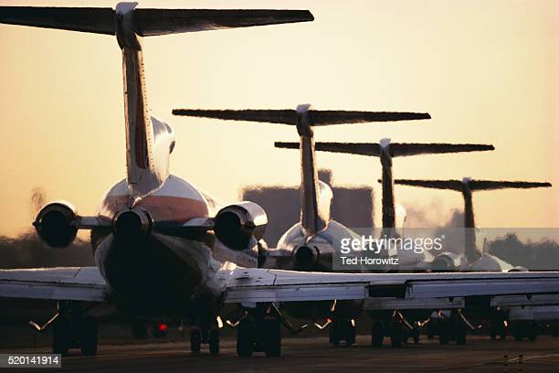 Airline Jets Lined up on Runway