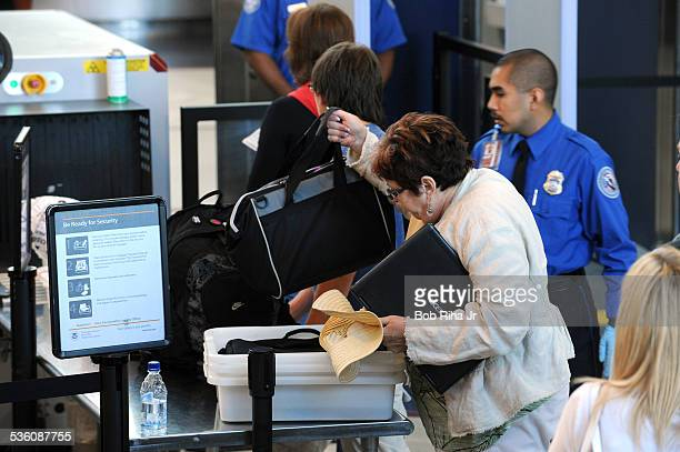 Airline passenger screening activity takes place by USTransportation Safety Administration agents at Los Angeles International Airport August 30 2010...