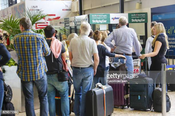 Airline passenger wait for a rental car at Alghero Airport on September 9 2014 in Cagliari Sardinia Italy