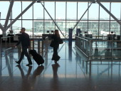 Airline passengers at Heathrow Airport terminal Five terminal 5 B gates looking towards the main terminal building Interiors Silhouette