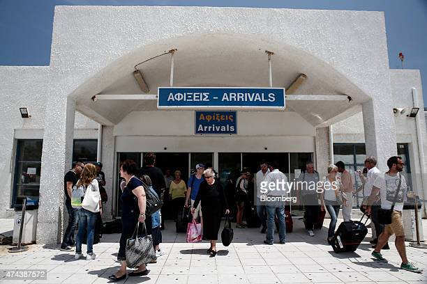 Airline passengers exit the arrivals hall after flying into Santorini airport on the island of Santorini Greece on Thursday May 21 2015 Greece will...