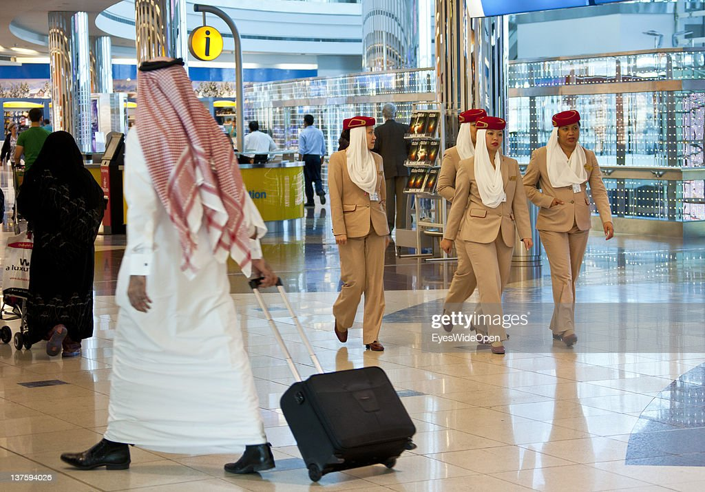 Airline passengers shopping in the transfer hall with duty free shops at Dubai Airport on December 25, 2011 in Dubai, United Arab Emirates