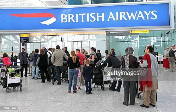 Airline passengers wait at the British Airways checkin desk in Terminal 5 at Heathrow airport in London UK on Monday May 17 2010 British Airways Plc...