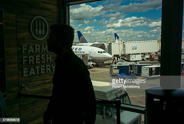 Airline passengers wait to order food May 26 2015 in the United Airlines terminal of the Denver International Airport in Denver Colorado