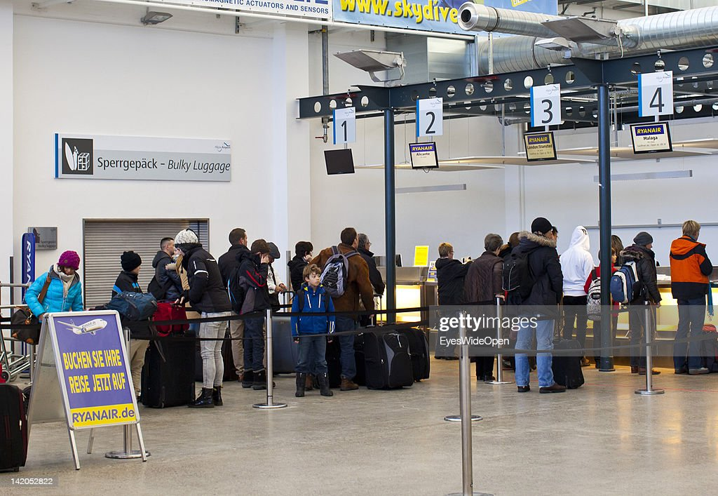 Airline passengers waiting for check-in or departure at Allgaeu Airport on February 18, 2012 in Memmingen, Germany.