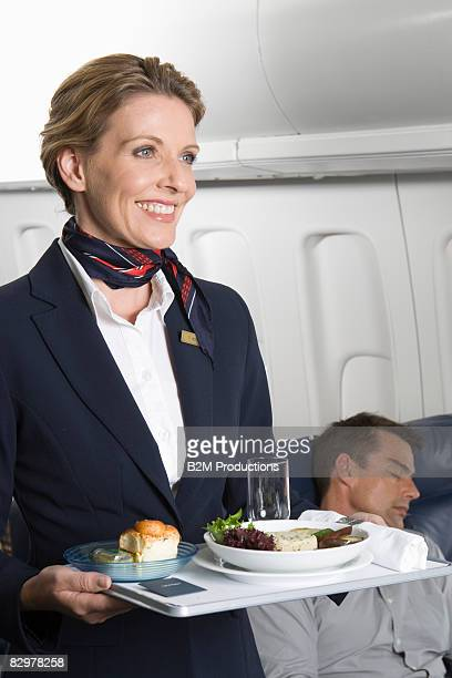 Airline stewardess holding tray