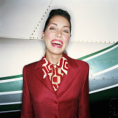 Airline stewardess smiling, portrait