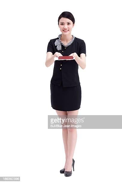 Airline stewardess with passport