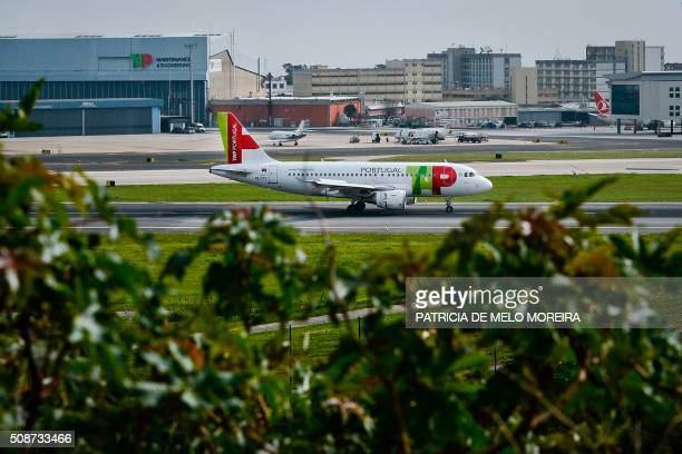 A TAP airline taxis at Lisbon's Airport on February 6 2016 Portugal's new Socialist government said Saturday it had lifted its stake in TAP to 50...