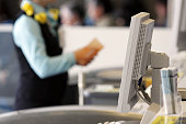 An airline ticket agent. Shallow dof, with focus on the monitor