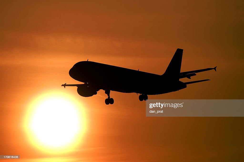 Airliner flying into the sun