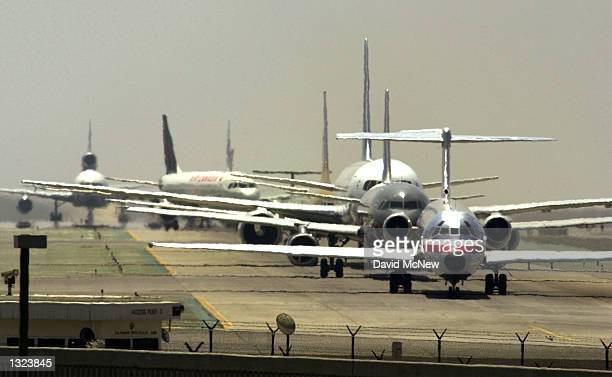 Airliners line up for take off at Los Angeles International Airport June 20 2001 in Los Angeles California According to a federal study LAX had the...