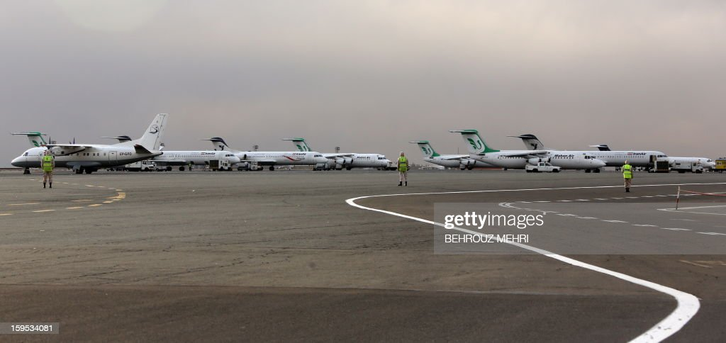 Iran Air and Mahan Air passenger planes sit on the tarmac of the domestic Mehrabad airport in the Iranian capital Tehran on January 15, 2013. Austrian Airlines said the previous day that it has stopped its flights to Tehran because they were not profitable any more in a decision that comes after the subsidiary of German carrier Lufthansa had already in November cut the number of weekly flights from Vienna to the Iranian capital to three.