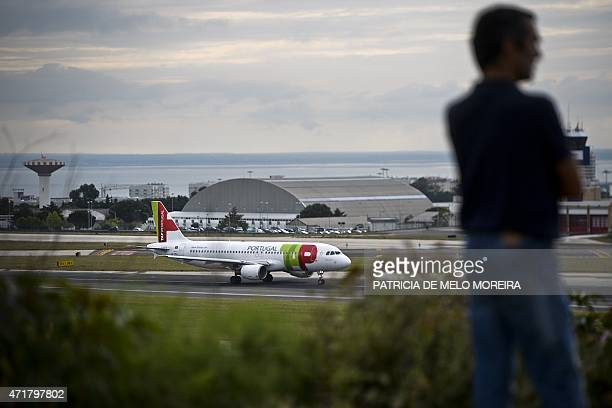 A TAP airline's plane speeds up to take off at Lisbon's Airport during a pilots strike on May 1 2015 Portuguese stateowned airline TAP pilots staged...
