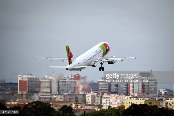 A TAP airline's plane takes off at Lisbon's Airport during a pilots strike on May 1 2015 Portuguese stateowned airline TAP pilots staged a ten days...