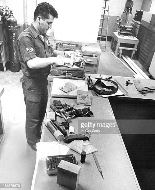 JAN 18 1963 FEB 6 1963 Airman 1/C Ray Zorens packs survival kit which contains sleeping bag shovel firstaid material and other items needed when...
