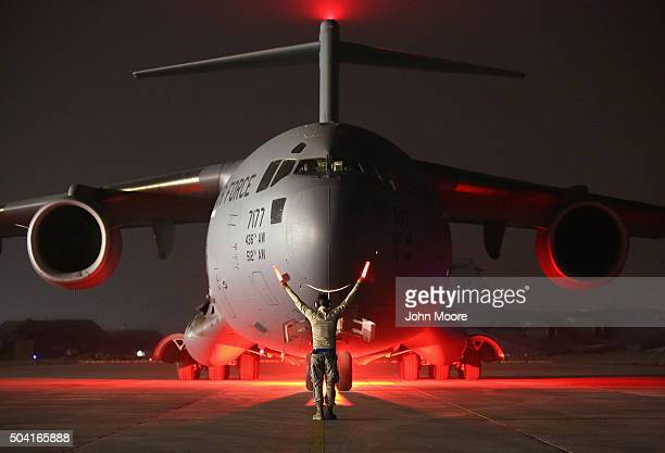 A airman guides a US Air Force C17 Globemaster after it returned from delivering cargo to Baghdad on January 9 2016 to a base in an undisclosed...