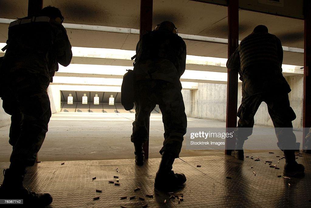Airmen test their skills at a shooting range.