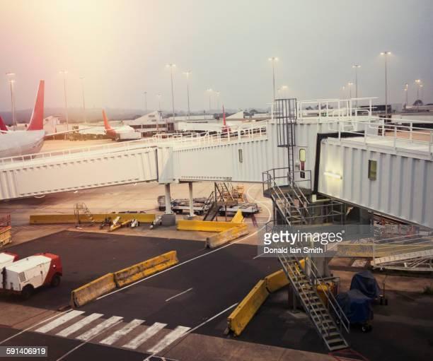 Airplane and elevated walkway on airport runway
