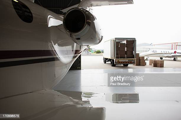 Airplane and truck being loaded with boxes