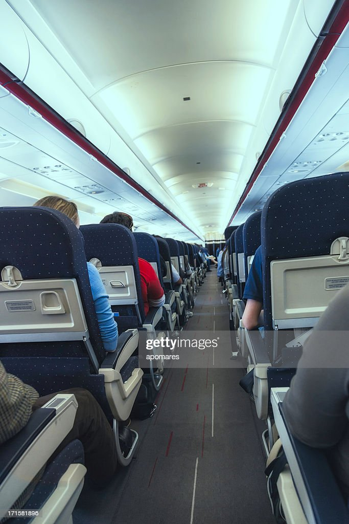 Airplane Cabin Aisle With Rear View Of Passengers Stock ...