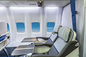 Empty business class airplane cabin with no passengers inside before take-off of the plane