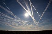 Airplane crossing sky