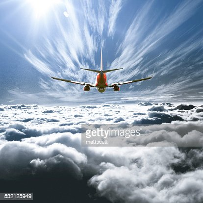 Airplane flying above the clouds : ストックフォト